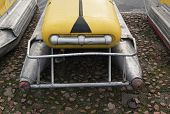 image of pedal  - front view of old yellow pedal boats ashore - JPG