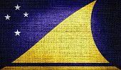Tokelau flag on burlap fabric
