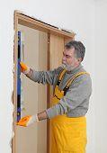 Builder Measure Verticality Of Door With Level Tool