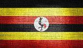 Uganda flag on burlap fabric