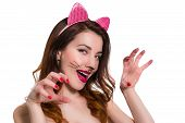 foto of love bite  - Playful lovely female in a role of catwoman make - JPG