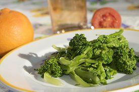stock photo of turnip greens  - traditional dish of Apuleia: stewed turnip greens ** Note: Shallow depth of field - JPG