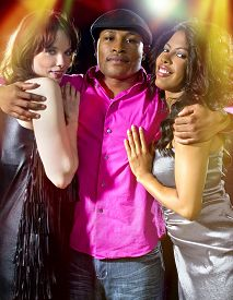 picture of swingers  - charming single man with two women at a nightclub - JPG
