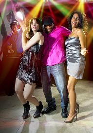 image of swingers  - charming single man with two women at a nightclub - JPG