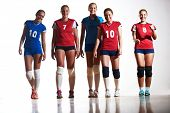 image of indoor games  - volleyball game sport with group of young beautiful  girls indoor in sport arena ball net - JPG