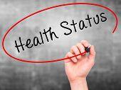 image of status  - Man hand writing Health Status on visual screen - JPG