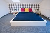 pic of enormous  - Enormous double bed with colorful sheet in modern bedroom - JPG