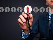 stock photo of recruitment  - Businessman hand with stethoscope - JPG