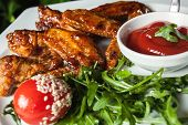 stock photo of fried chicken  - Delicious fried chicken legs with pepper and sauce - JPG