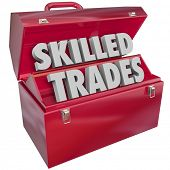 picture of blue-collar-worker  - Skilled Trades words in 3d letters in a red metal toolbox to illustrate blue collar work in a technical or mechanical job or career - JPG