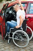 picture of handicapped  - Handicapped Man Sitting On Wheelchair Boarding In His Car - JPG