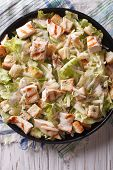 pic of caesar salad  - Caesar salad with chicken closeup on the plate - JPG