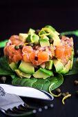 pic of tartar  - Tasty salmon and avocado tartar dark background - JPG