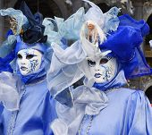 picture of carnivale  - two women dressed up for a mardi gras style parade in st marks square veniceitaly for carnivale - JPG