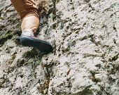 stock photo of climb up  - Woman climbing on rock - JPG