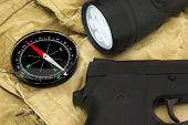 pic of handgun  - Black Handgun Magnetic Compass And Led Tourchlight On The 
