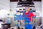 image of auto repair shop  - Happy handyman in overalls with hands on hip against auto repair shop - JPG