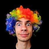 picture of wacky  - A silly crazy man wearing a clown wig with rainbow colors - JPG
