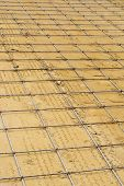 stock photo of concrete pouring  - Mesh steel rod for construction reinforcement before pouring concrete - JPG