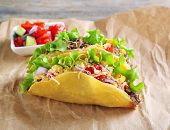 picture of tacos  - Tasty taco with vegetables on paper close up - JPG