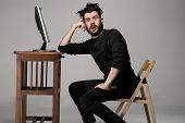 picture of crazy face  - Funny and crazy man using a computer on gray background - JPG