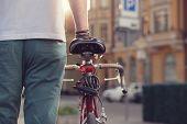 picture of biker  - Closeup of stylish biker with vintage race bike - JPG