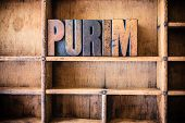 stock photo of purim  - The word PURIM written in vintage wooden letterpress type in a wooden type drawer - JPG