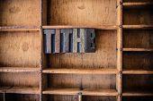 image of tariff  - The word TITHE written in vintage wooden letterpress type in a wooden type drawer - JPG
