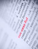 stock photo of glossary  - the red word successful in a glossary macro blue toning - JPG