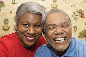 Close up portrait of mature African American couple smiling at viewer.