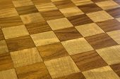 Brown and tan checkered wooden floor.