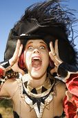 Close up of young adult Caucasian female dressed in pirate costume.