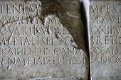 Script carved in stone in Capitoline Museum, Rome, Italy.