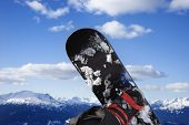Snowboard and mountain in Whistler, British Columbia, Canada.
