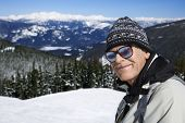 Caucasian senior man  skier in goggles posing on mountain Whistler, British Columbia, Canada.