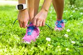Постер, плакат: Active lifestyle smartwatch runner woman tying running shoes Healthy summer living Sports girl get