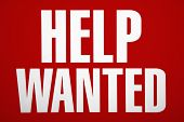 Red help wanted sign.