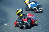 stock photo of luge  - a street luge glides super fast down a hill - JPG