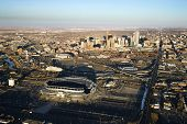 Aerial cityscape of urban Denver, Colorado, with Mile High stadium in foreground.