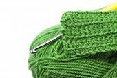 Skein Of Wool, Crochet Hook  And Knitted Piece Isolated On White