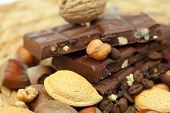 picture of pecan nut  - bar of chocolate and nuts on a wicker mat - JPG
