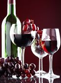 stock photo of wine grapes  - a glass of red wine and grape - JPG