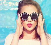 Colorful portrait of young attractive woman wearing sunglasses. Summer beauty  concept poster