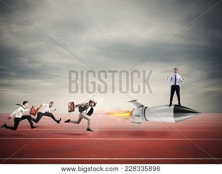 poster of Winner Businessman Over A Fast Rocket Against Competitor. Concept Of Business Competition