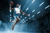 Basketball Player In Motion Or Movement On Big Professional Arena During The Game. Player Making Sla poster