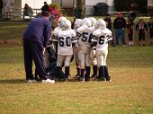 American Football Team Huddle