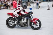 WENDOVER, UT - AUGUST 13: A 1000cc Honda motorcycle races on the Bonneville Salt Flats during Bonnev