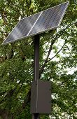 Solar Panel Surrounded By Green Trees