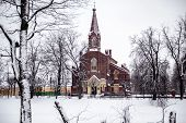 Lutheran Church Of The Resurrection Of Christ In Winter. The Finnish Evangelical Lutheran Parish In  poster