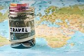 Travel Savings Money Concept. Collecting Money In Moneybox For Travel. Money Jar With Coins And Bank poster